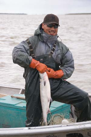 yukon river fisherman with king salmon